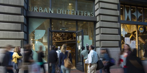 Pedestrians walk by an Urban Outfitters Inc. store in San Francisco, California, U.S., on Friday, Aug. 15, 2014. Urban Outfitters Inc. is scheduled to release earnings figures on Aug. 18. Photographer: David Paul Morris/Bloomberg